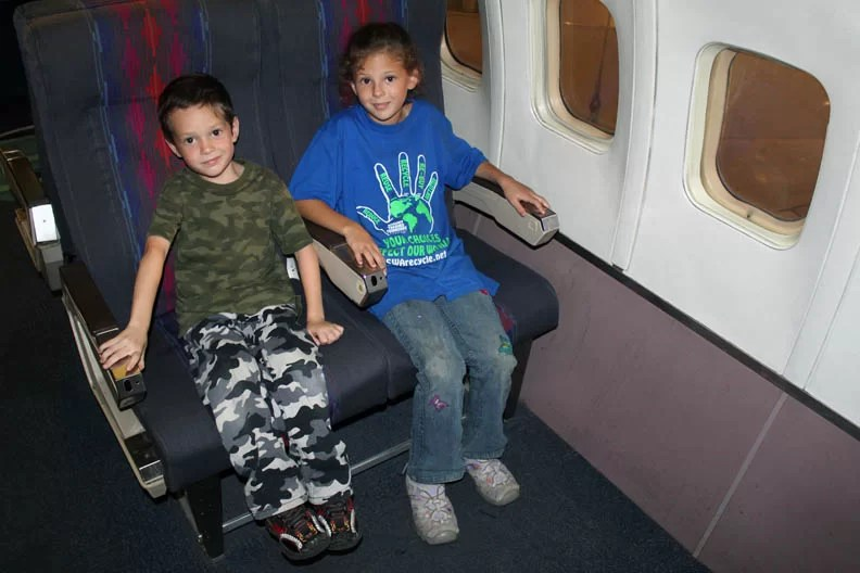 Tips on Traveling Overseas With Kids; Don't let them just sit being bored during the flight or they will more than likely cause trouble.