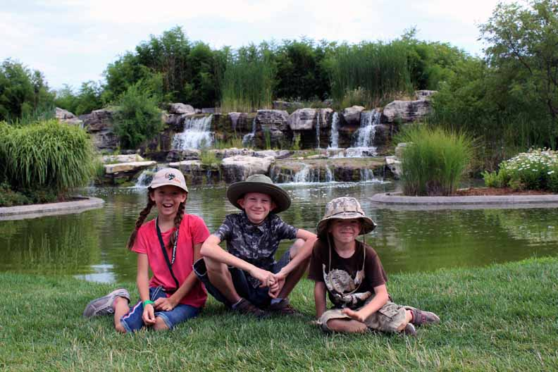 kids-in-front-of-a-water-fall