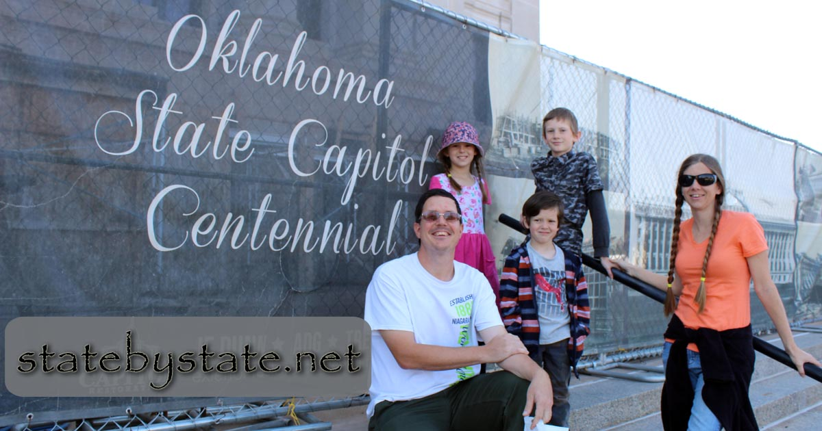 family in front of Oklahoma's State Capitol