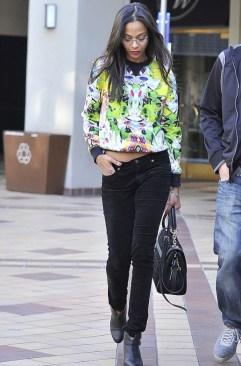 zoe-saldana-stylechi-best-looks-yellow-green-graphic-jumper-black-skinny-jeans-boots-bag-street-style