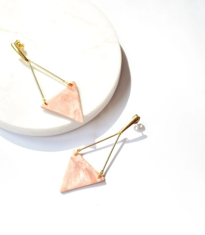 pink dangling earrings