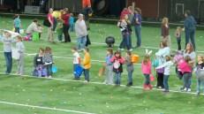 Kids eagerly waiting for the Easter egg hunt to start.