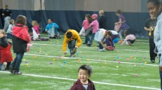 Kids scrambling to pick up as many eggs as possible.