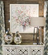 Glass home decor vase like canisters with delicate modern silver metallic lamp to cooperate with soft wall artwork on the wall