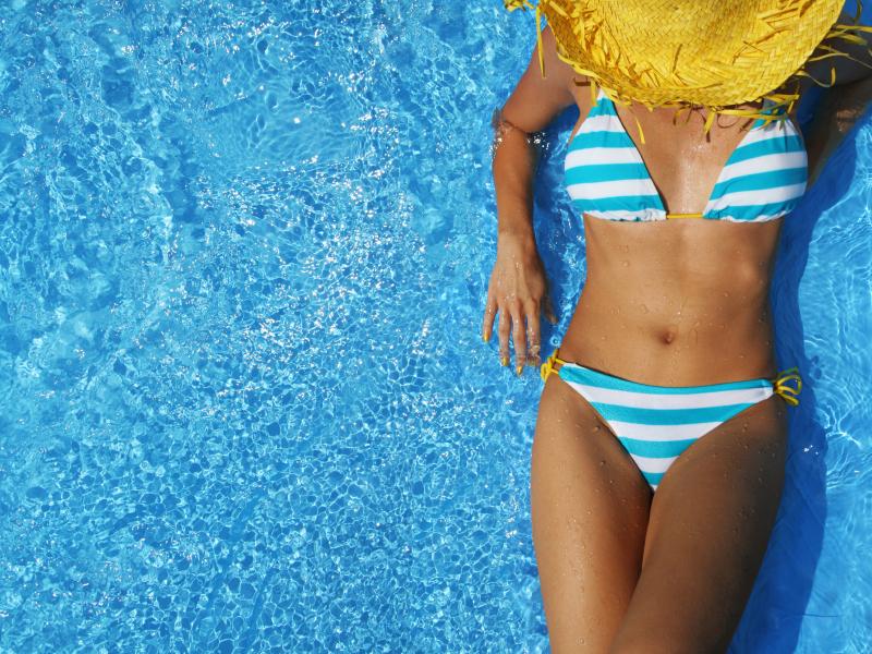 Sunbathing in a bikini at the pool
