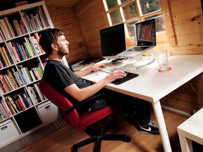 man at desk designer computer