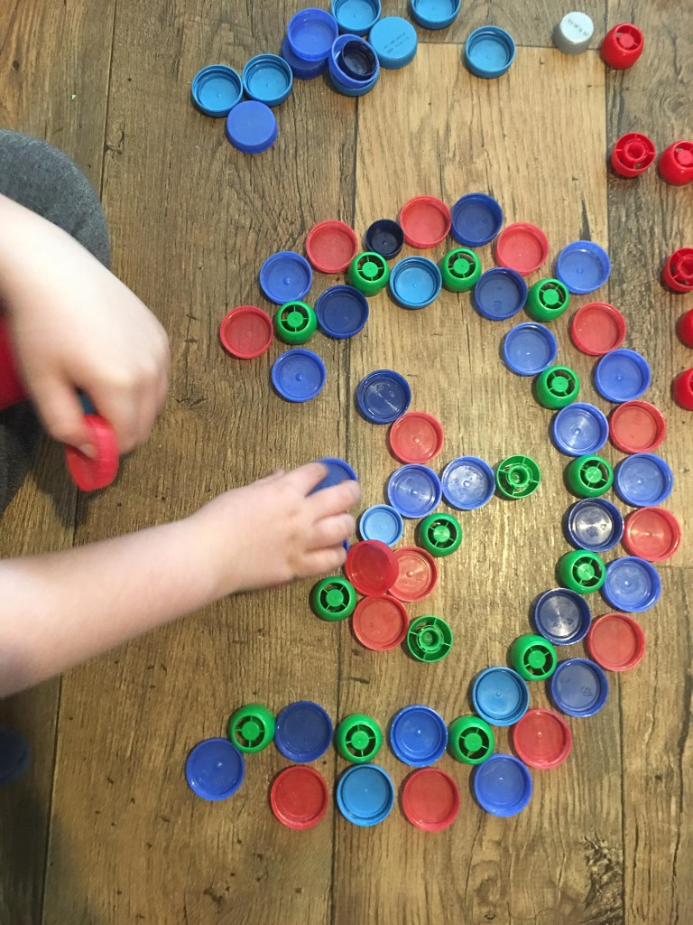 making mandalas with bottle tops