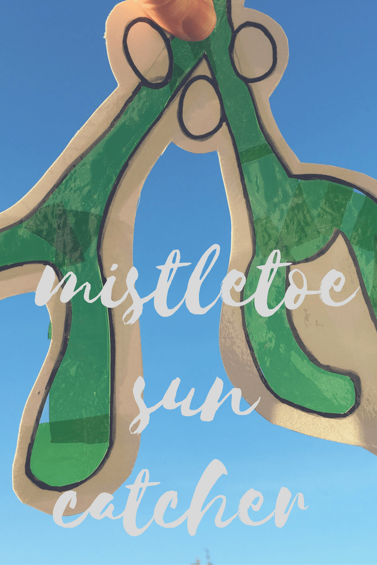 Mistletoe sun catcher against a blue sky