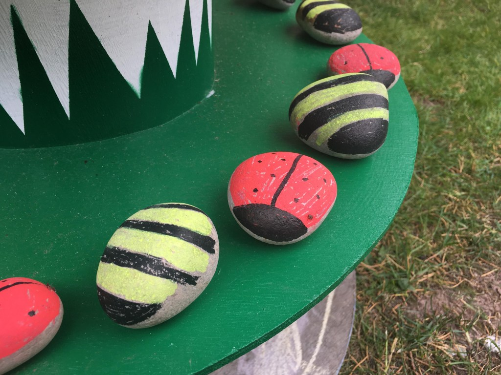 painted stone ladybirds and bees