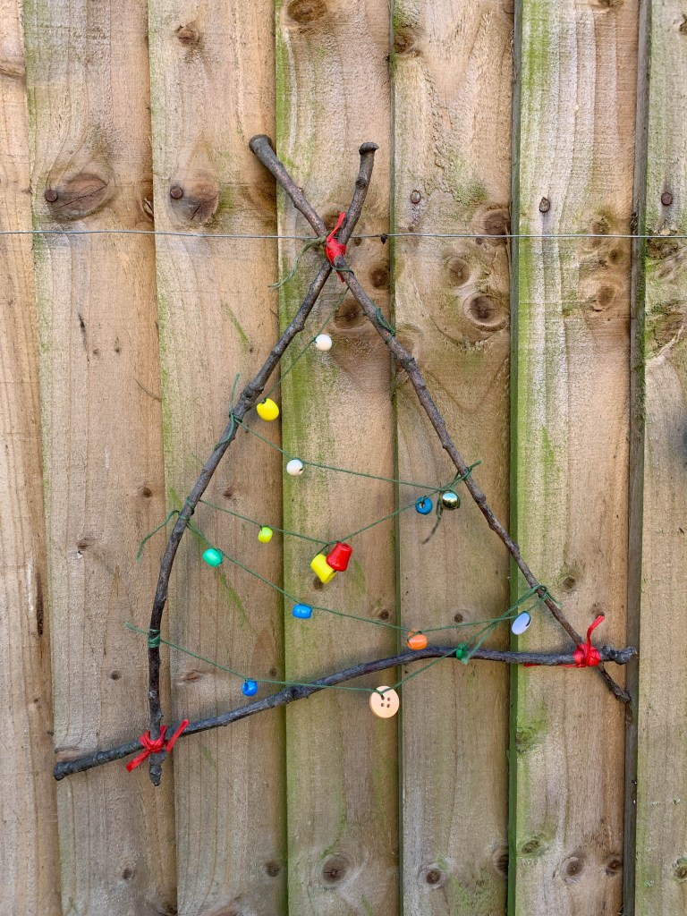 twig tree decoration decorated with beads from the gingerbread house blog