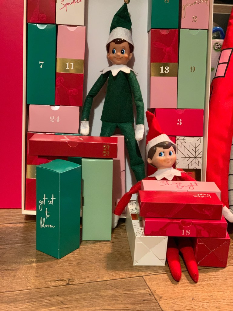 Elf on the Shelf playing with the Advent calendar