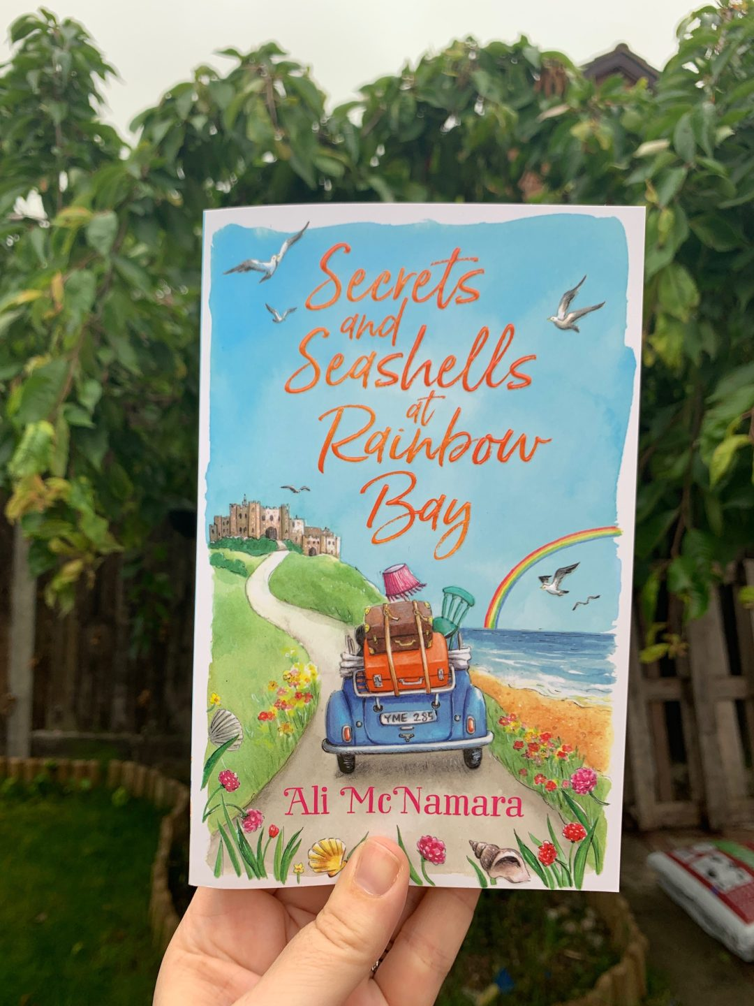 cover of Secrets and Seashells at Rainbow Bay by Ali McNamara