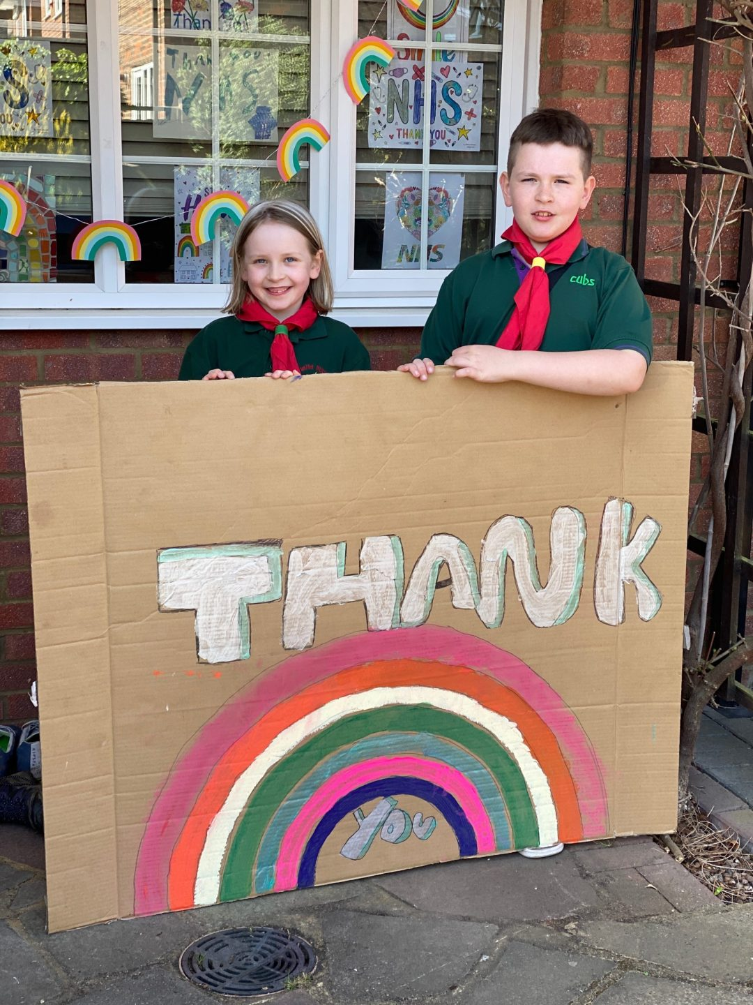 Cub Scouts with their Thank the NHS Sign