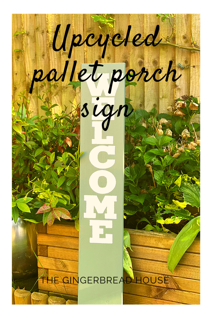 Upcycled pallet porch sign from the gingerbread house