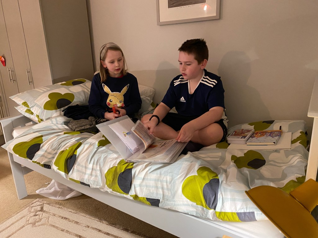 kids sitting on their bed