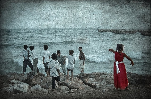 Yemenite kids on a beach by Wix photographer Gaelle Lunven