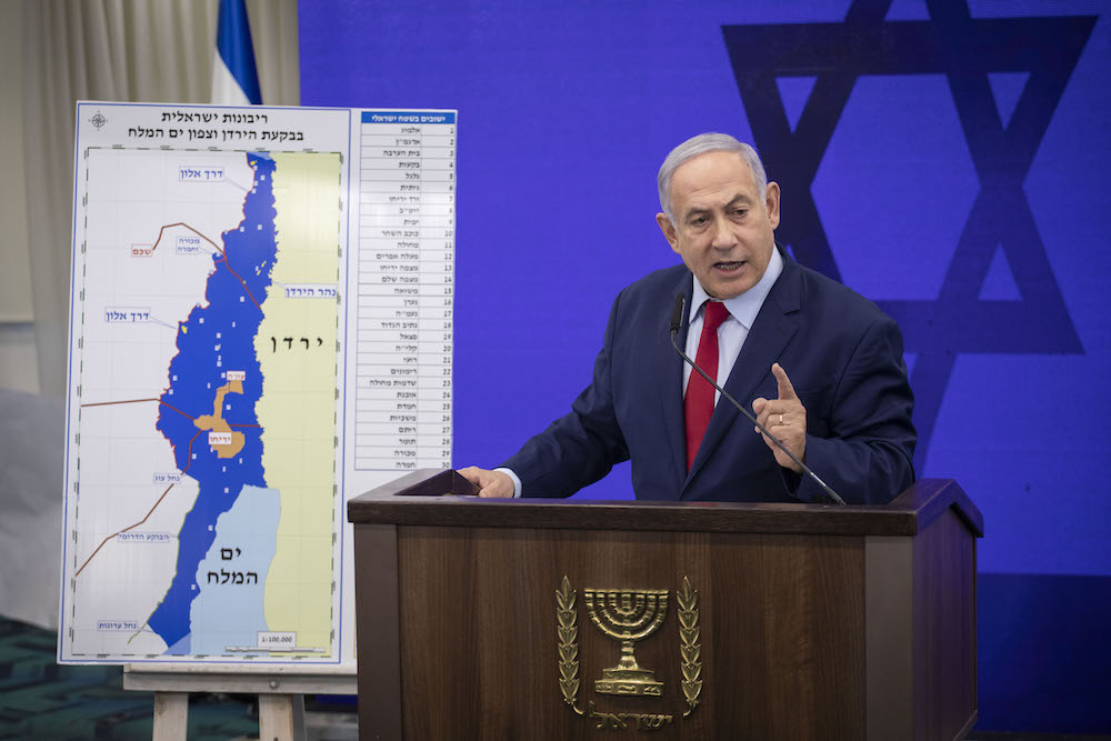 Prime Minister Benjamin Netanyahu stands beside a map of the occupied Jordan Valley during a press conference in the run up to the second elections of 2019, Ramat Gan, September 10, 2019. (Hadas Parush/Flash90)