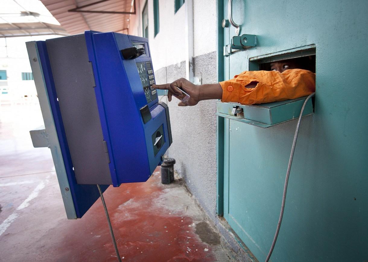 A prisoner seen making a phone call in Gilboa Prison, northern Israel, February 28, 2013. (Moshe Shai/Flash90)