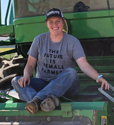 Montana farmer Michelle Jones sits on her combine