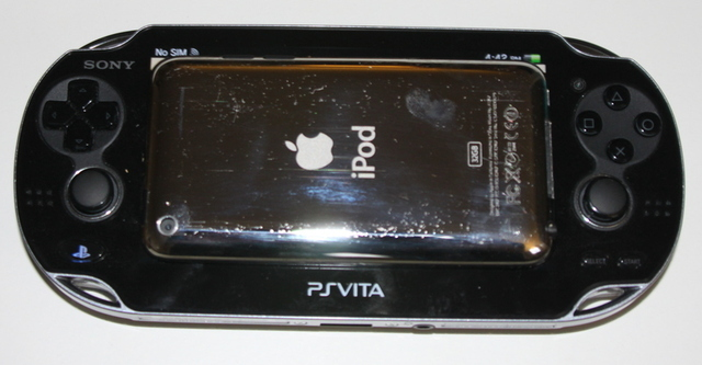An entire iPod Touch can't quite cover the viewable screen area on the PlayStation Vita