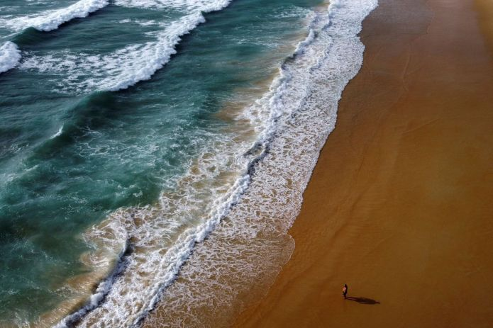 A man walks at the empty Karon beach in Phuket. Picture was taken on April 1 this year with a drone. (Reuters photo)