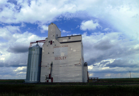 The little towns of North Dakota and Saskatchewan each have a grain elevator.
