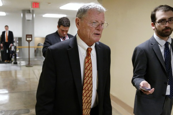 U.S. Senator James Inhofe (R-OK) (C) is greeted by a reporter as he arrives for the weekly Senate Republican caucus luncheon at the U.S. Capitol in Washington January 13, 2015.