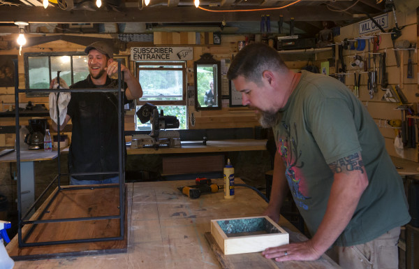 Matthew Stepp (left) and Mike Weston of Rusted Raven Furniture Co. upcycle furniture at their workshop in Hampden.