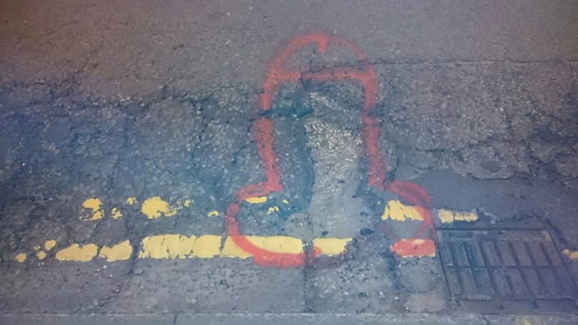wanksy-penis-pothole-graffiti-manchester-england-3