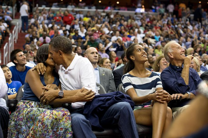 """President Barack Obama Kisses First Lady Michelle Obama For The """"Kiss Cam"""""""