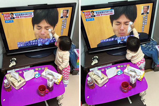 Baby Trying To Dry The Tears Of A Japanese Politician