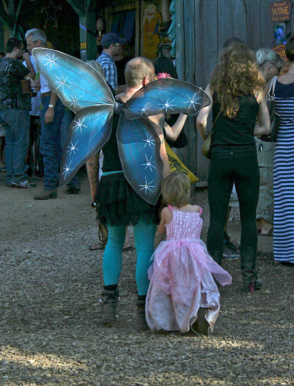 Single Father With His Daughter, Dressed As A Fairy And Princess