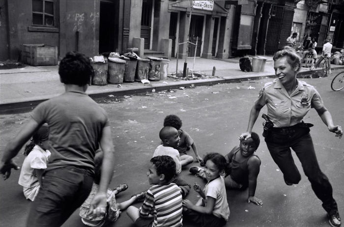 Police Officer Playing With Children, Harlem, 1978