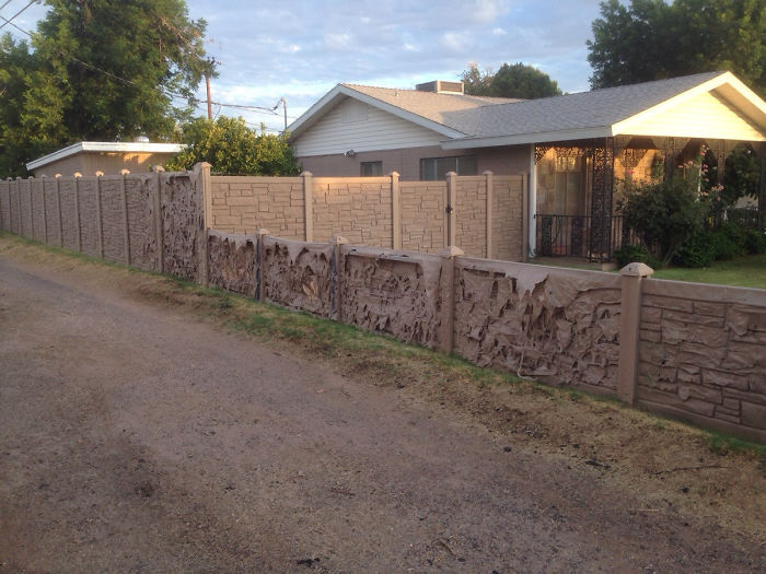 My Neighbors Put Up This Fake Rock Plastic Wall Over The Winter. It's Slowly Melting Away In The Heat