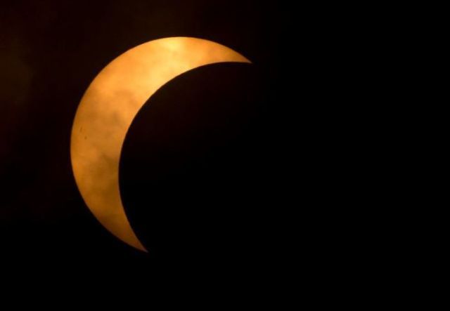 Close Obscure The Moon As It Covers A Part Of The Sun During A Partial Eclipse In Richmond, Va
