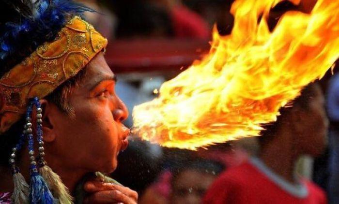 Fire Breather Looks Like He's Kissing A Fire Dragon