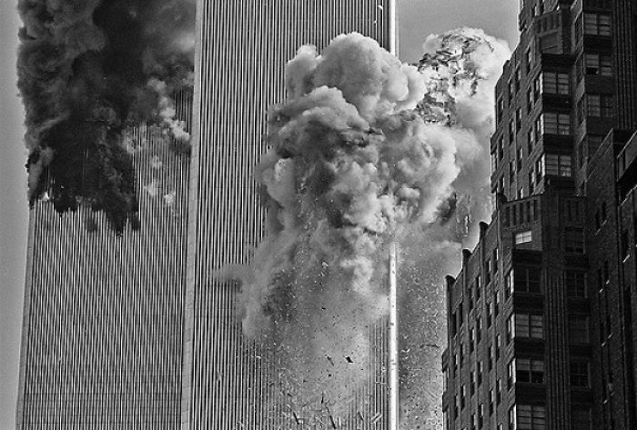 The Second Plane Flew Directly Over My Head And Slammed Into The South Tower. It Took Me A Few Seconds To Get My Head Together, And This Was The Shot I Took