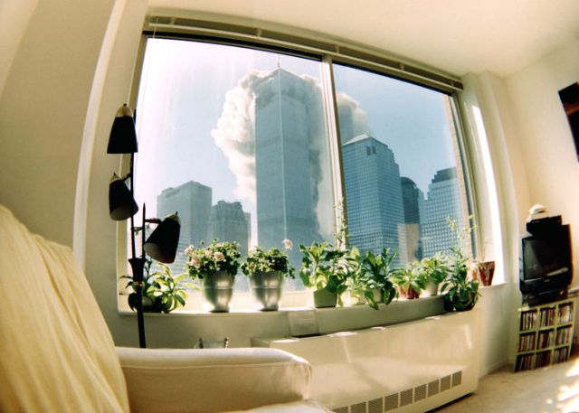 As Seen Through A Fish-Eye Lens From An Apartment Four Blocks Away, Smoke Streams From The North Tower Within Minutes Of The First Plane's Attack