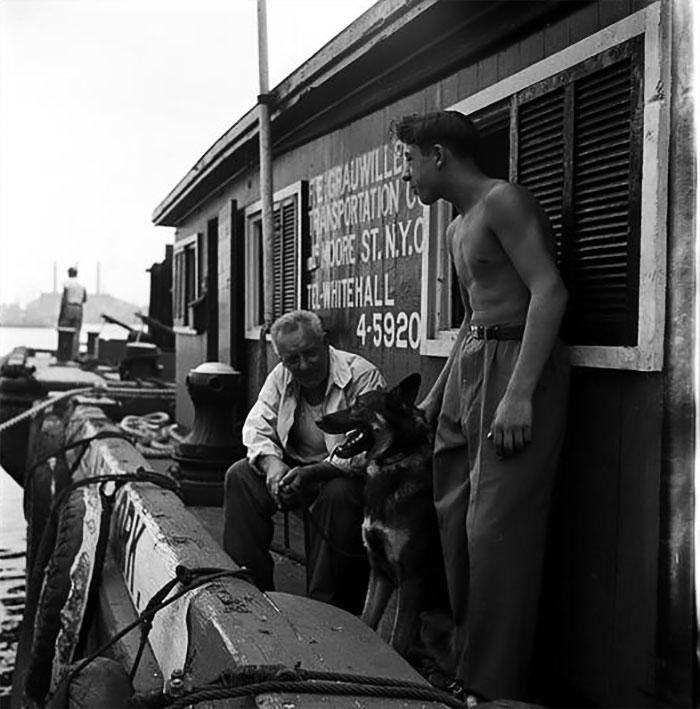 Men With German Shepherd On A Dock, 1949