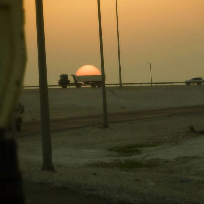 Snapped A Lucky Shot Of A Truck Trying To Steal The Sun
