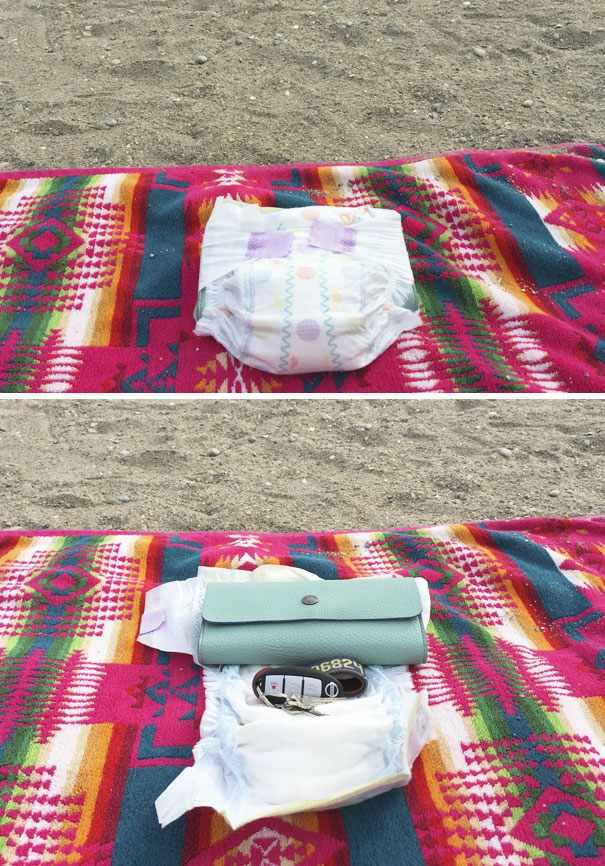 Roll Up Your Valuables In A Diaper To Keep Them Safe At The Beach