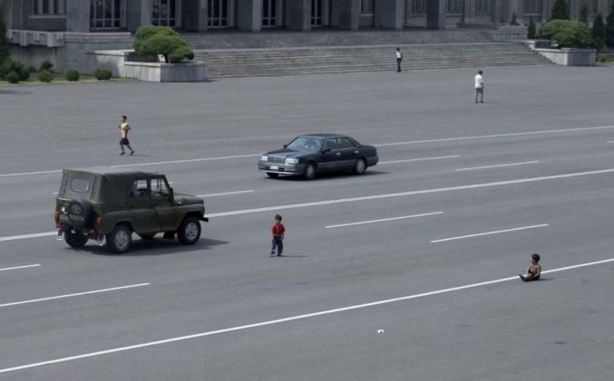 As Cars Have Become More Widespread In Pyongyang, The Peasants Are Still Getting Accustomed To Seeing Them. Kids Play In The Middle Of The Main Avenues Just Like Before When There Were No Cars In Sight