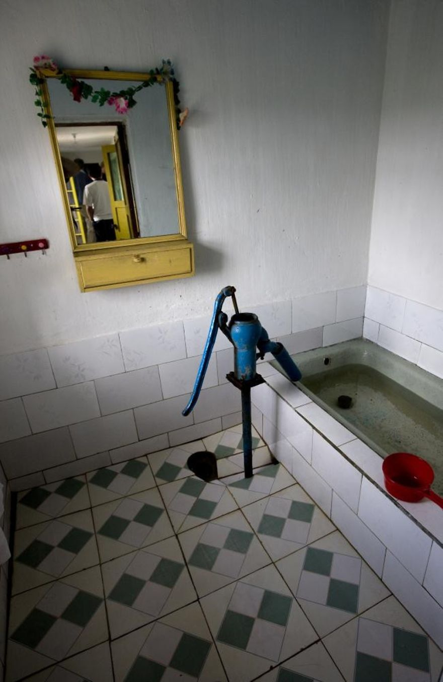 A Visit To A Rural Home. Those Houses And The Families Who Live There Are Carefully Selected By The Government. But Sometimes, A Detail Like A Bathroom Used As A Cistern Shows That Times Are Hard…