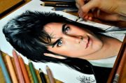 artist draws realistic portraits