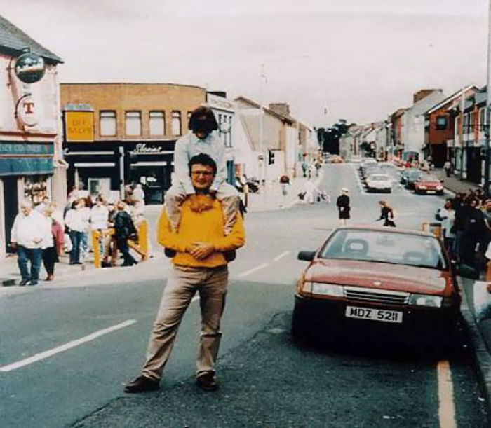 The Omagh Bombing. The Red Car In This Photograph Contained A Bomb That Killed 29 People And Injured Some 220 Others. The Man And Child Both Survived, The Photographer Didn't