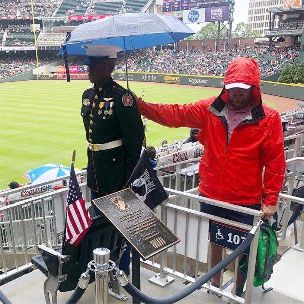 Baseball Fan Holding Umbrella Over JROTC Member On Memorial Day