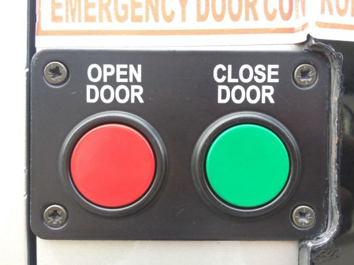 The Color Choice For The Emergency Door Buttons On A Bus