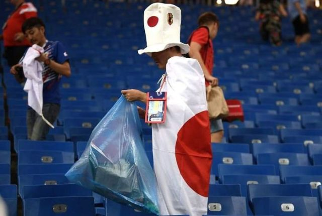 Japan Went Down To A 94th Minute Goal. And Still The Fans Stayed Behind After The Final Whistle To Collect Rubbish And Clean The Stadium