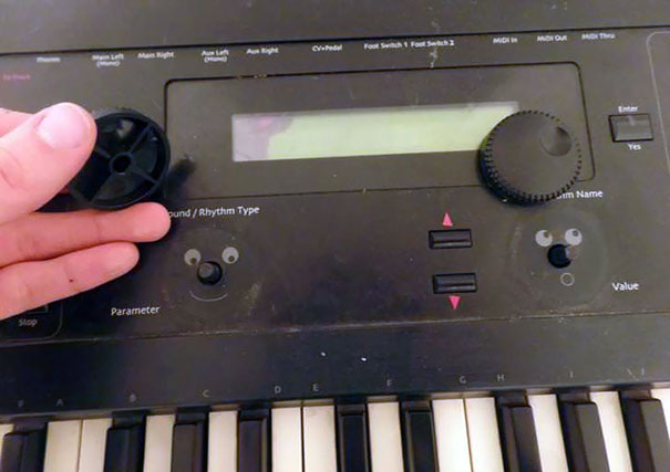 Smiley Faces Under Keyboard Knobs