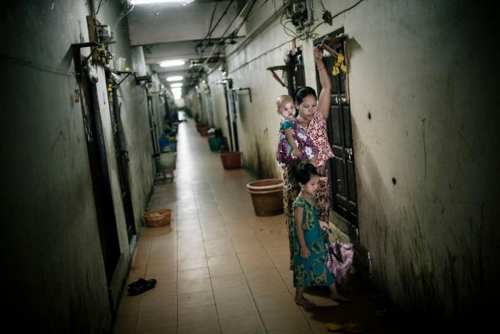 Burmese Migrant Walks In The Hallway Of The Tenement That Houses Burmese Workers In The Thai Fishing Industry In Samut Sakhon